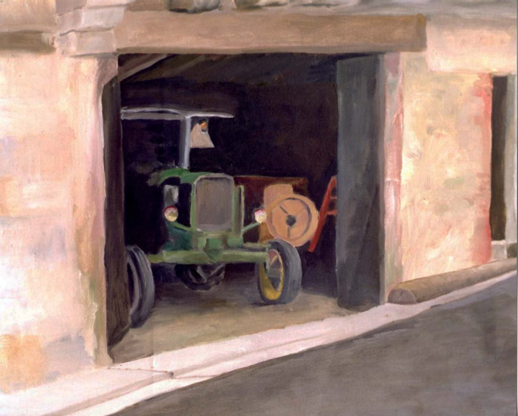 hugh moore tractor in shed in oil