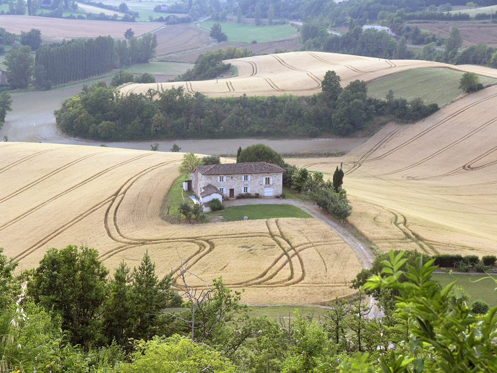 lanscape with house and striped fields